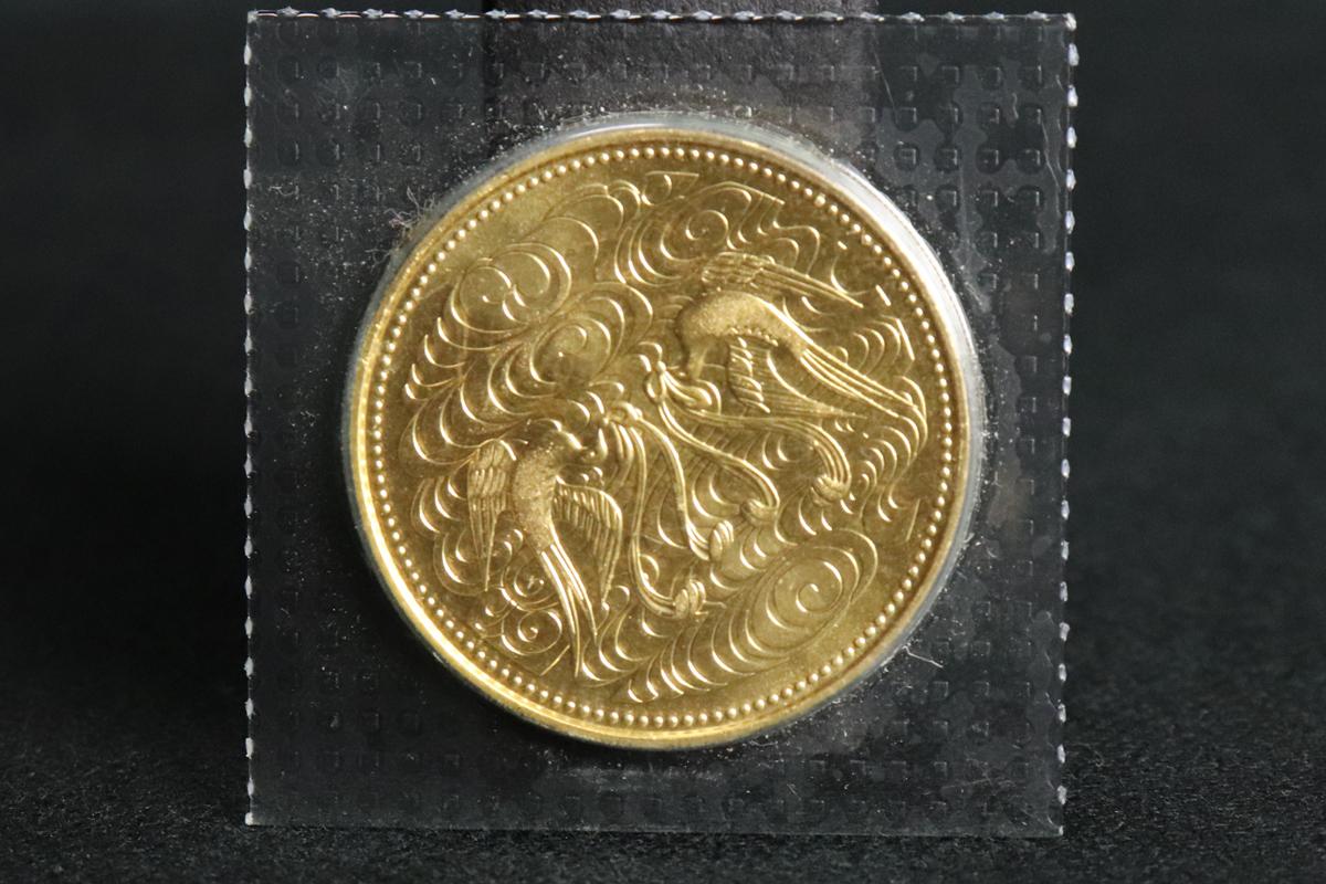 天皇陛下御在位60年記念/10万円金貨
